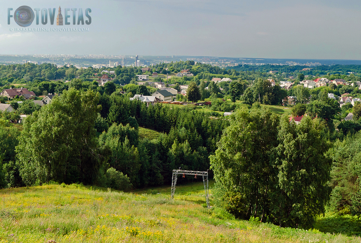 panorama view over Vilnius from Laimis hill with green forests and private housing suburbs