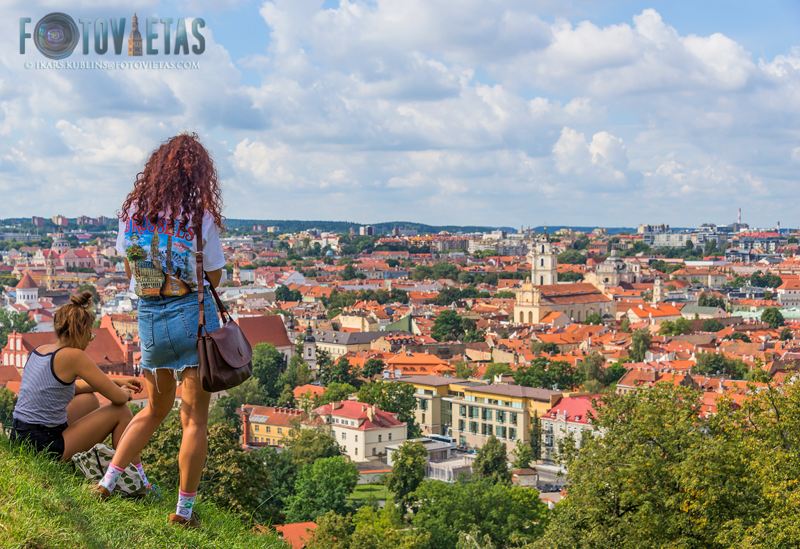 Two girls looks over Vilnius city from the Hill of Three Crosses