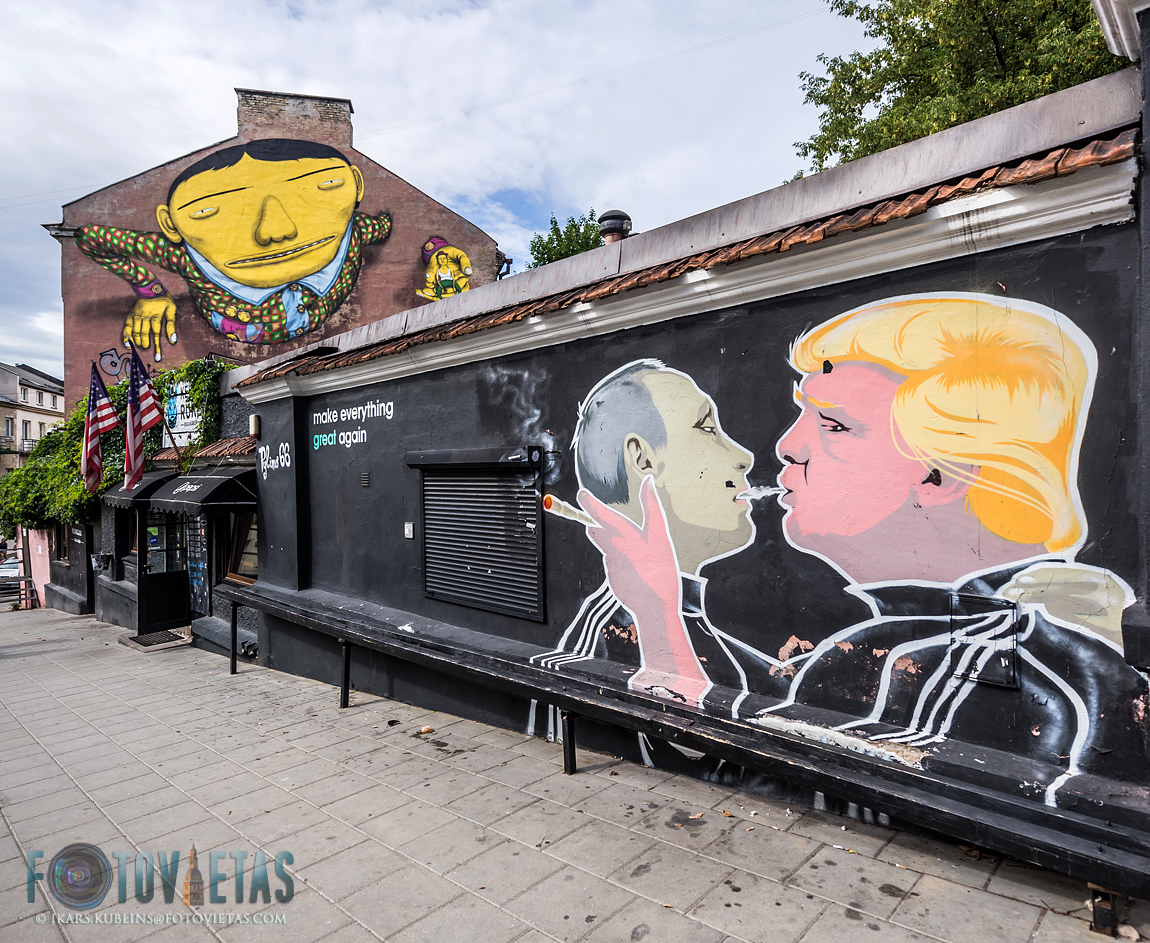 mural graffitti of Donald Trump and Vladimir Putin on the wall in Vilnius